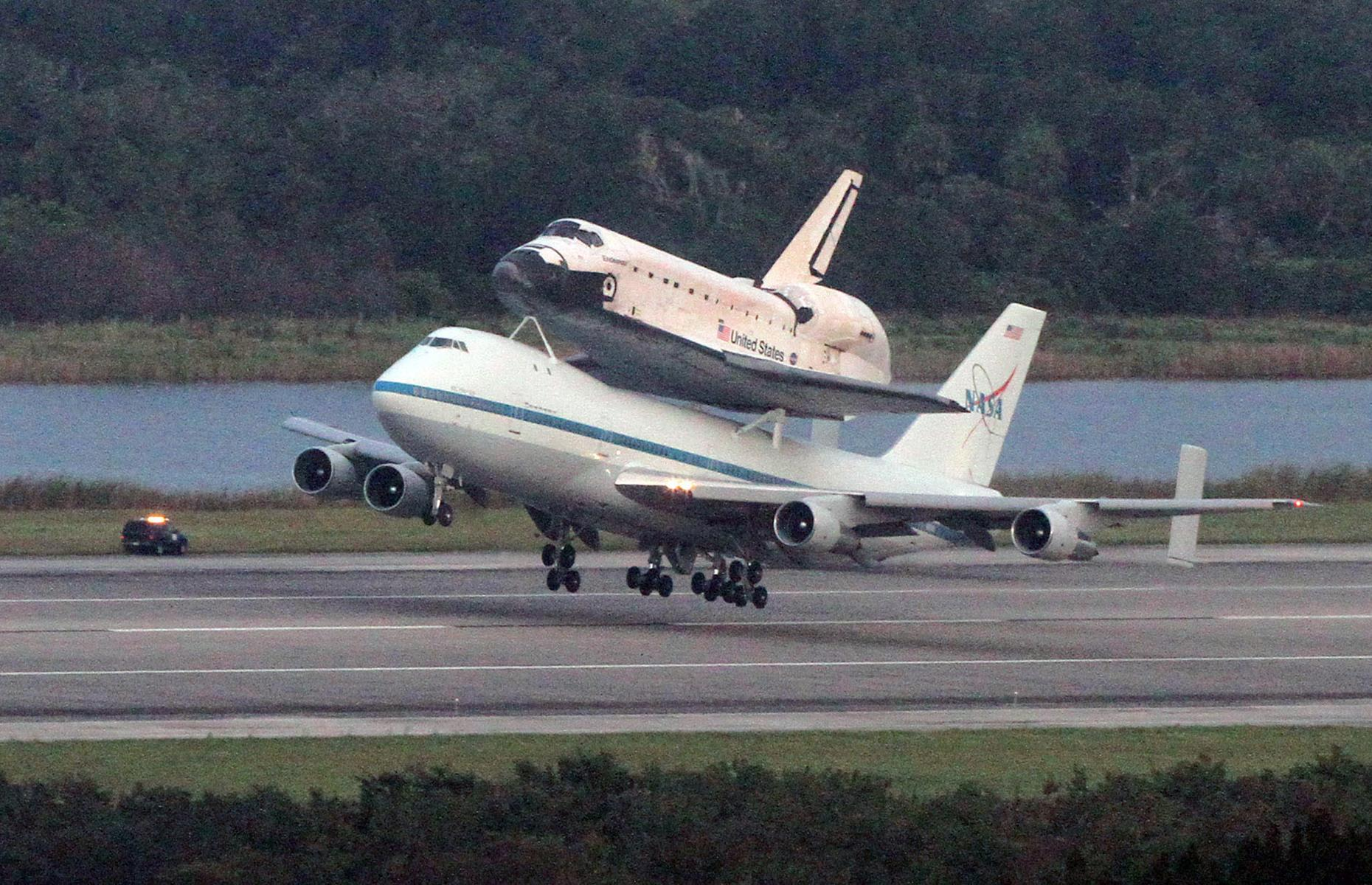 Slide 34 of 35: The plane could carry hundreds of passengers across continents, making mass tourism possible and affordable. The airliner also famously carried the Space Shuttle on its back in 2012, when the Endeavour spacecraft was moved from the Kennedy Space Center in Florida to Los Angeles, California.