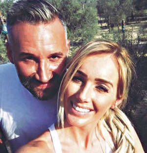a man and a woman taking a selfie: Dane Bowers