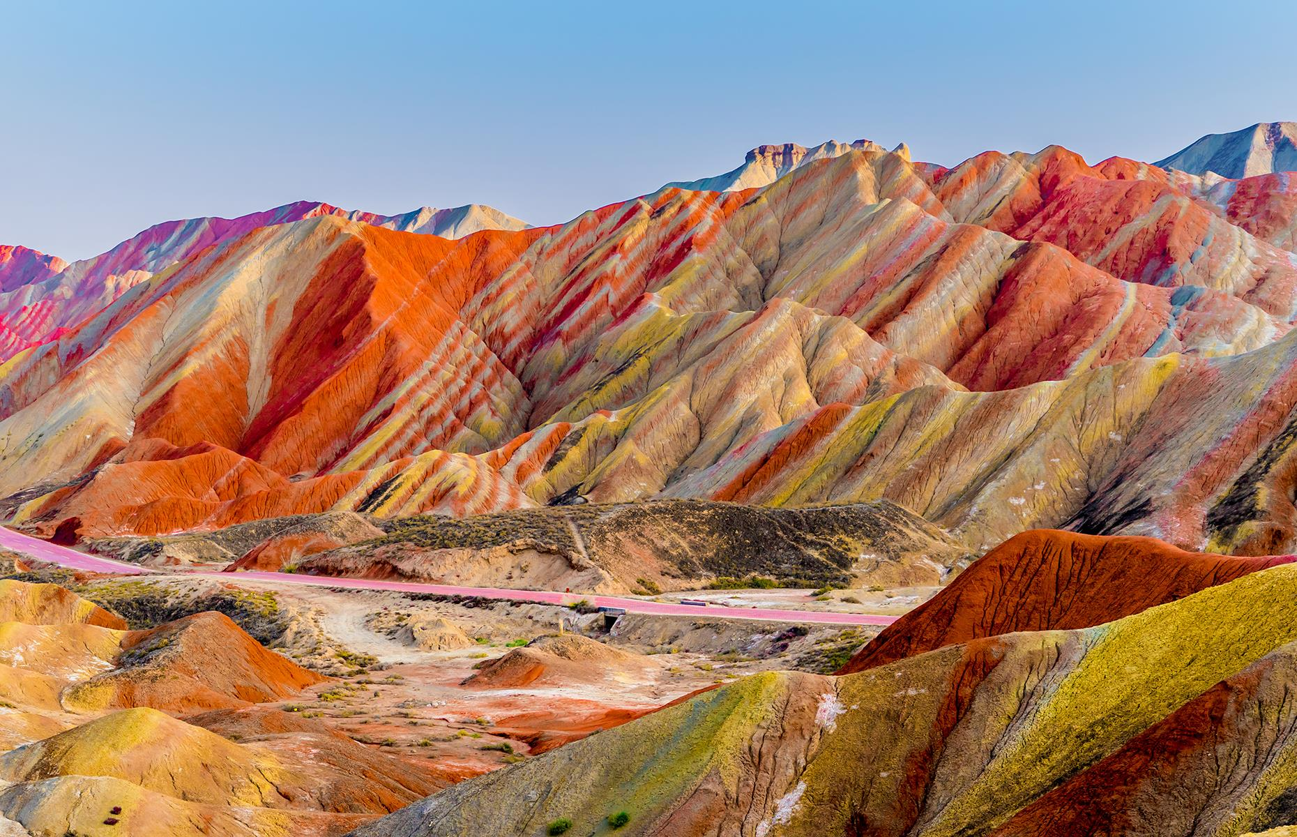Slide 43 of 43: The rainbow-hued mountains in Zhangye National Geopark look just like an artist's brush strokes. Part of a UNESCO World Heritage Site, this stunning formation was created by natural erosion, when layers of sand, silt, iron and minerals blended together to create a kaleidoscope of colors. The incredible park appears to have been decorated by Mother Nature herself.