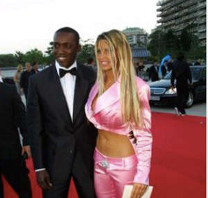 Dwight Yorke wearing a suit and tie: Dwight Yorke Katie Price