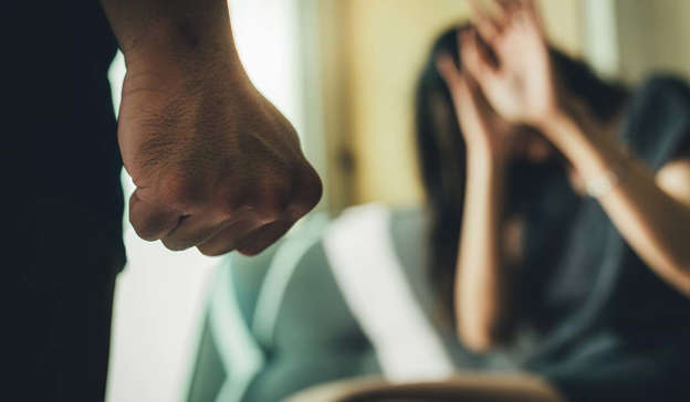 a blurry image of a man: COVID-19 lockdown measures have many worried that victims of domestic abuse are likely to be trapped at home with their abusers Pic: Shutterstock