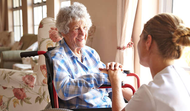a man and a woman looking at each other: A Longford nursing home has been forced to stop all visitations after a number of positive COVID-19 cases have been detected. Pic: Getty Images