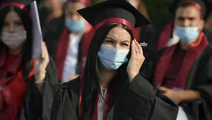 Students of the the Polytechnic Institute wear face masks during the graduation ceremony for the 2020 university year in Bucharest, Romania, Sunday, July 12, 2020. Romania has registered a growing number of COVID-19 infections over the past week, with the highest levels since the pandemic started in the country in February. (AP Photo/Andreea Alexandru)