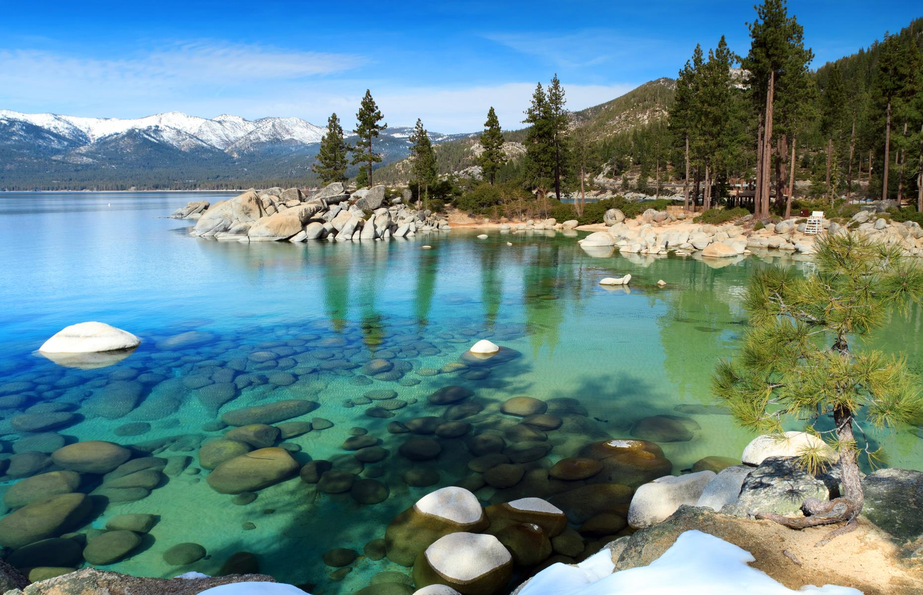 Slide 6 of 31: Lake Tahoe, a freshwater lake straddling the California and Nevada border, is mesmerizing. Its clear blue waters sparkle against a backdrop of the Sierra Nevada Mountains. It's truly a sight to behold.