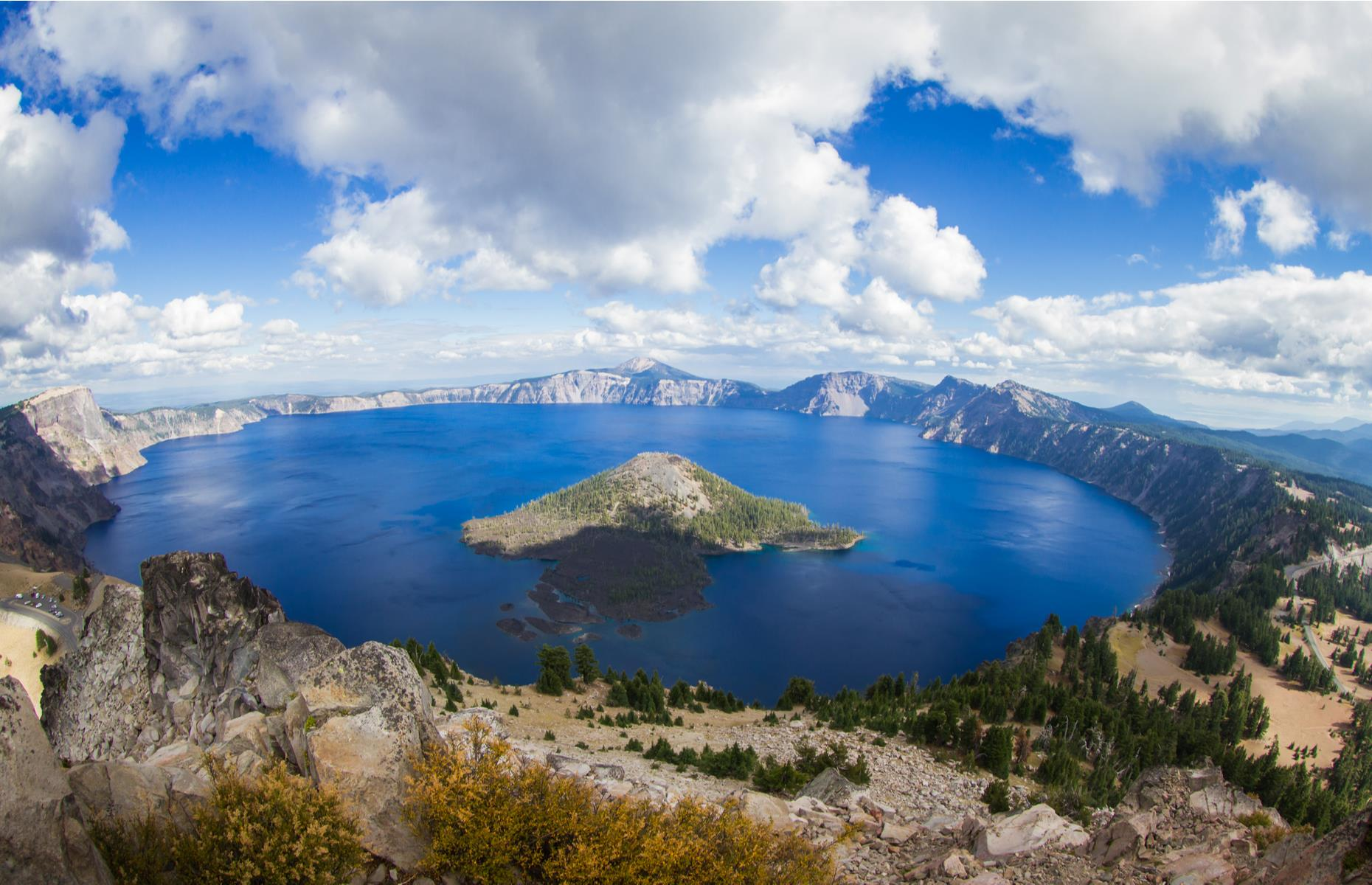 Slide 28 of 31: America's deepest lake (a staggering 1,943 foot/592m) is often the most camera-shy. In winter, it can hide in a wall of fog but if it clears, the blindingly blue water of this caldera basin is breathtaking. Now discover the world's most beautiful waterfalls.
