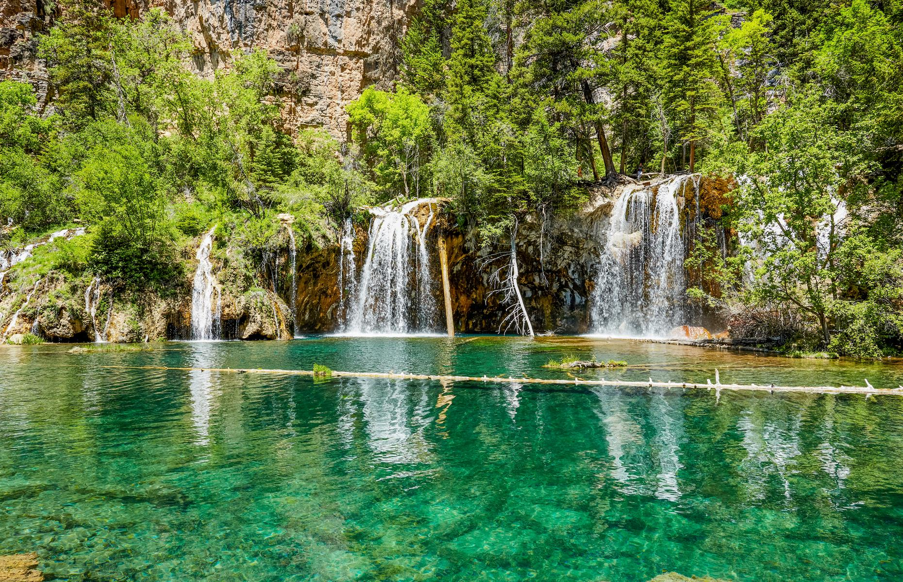 Slide 24 of 31: Waterfalls cascade into shimmering, spearmint-hued pools at Hanging Lake, located in Glenwood Canyon. The lake is so-named because it appears to hang from a cliff and its dramatic beauty more than makes up for its small size.