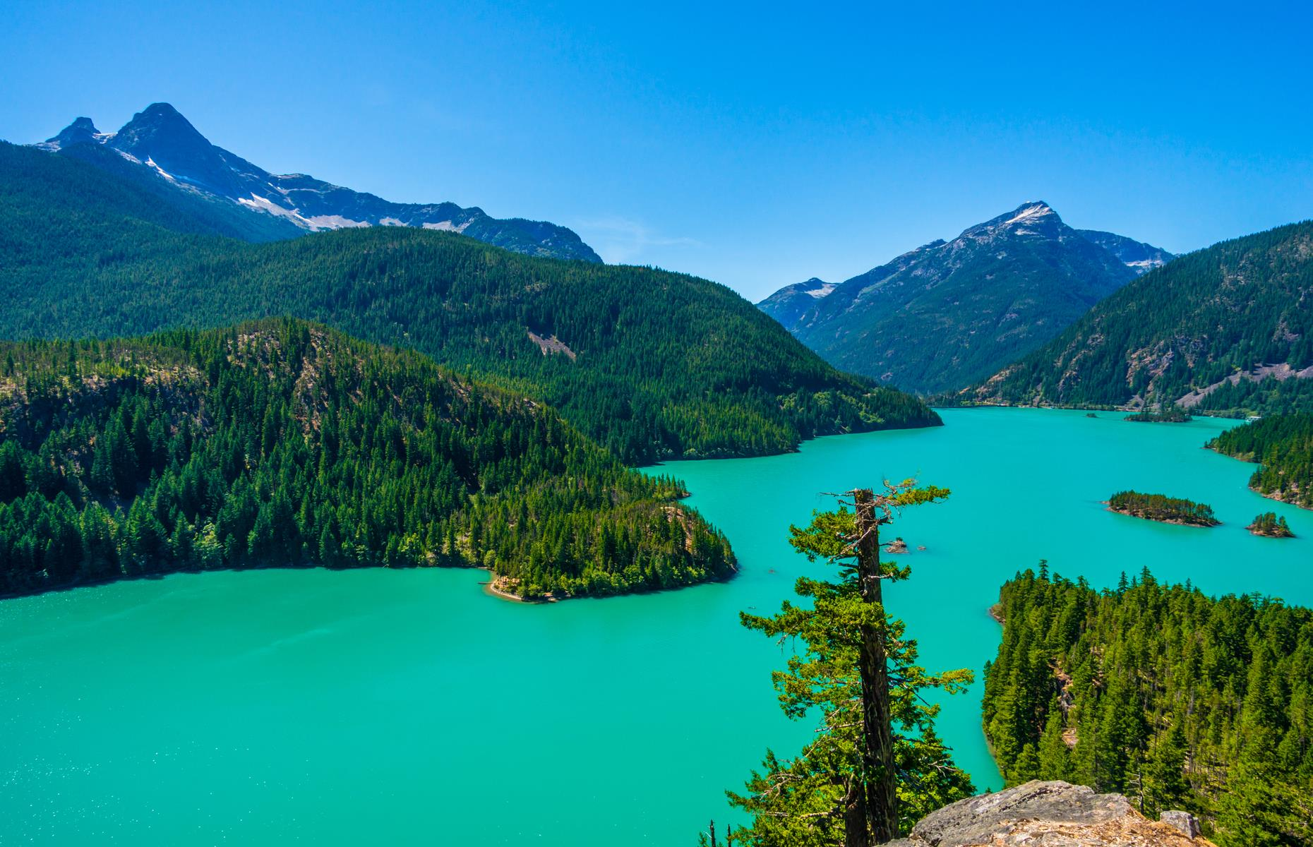 Slide 18 of 31: Many lakes are described as turquoise but Diablo Lake outdoes them all. Its vivid appearance is caused by flour-like particles ground from the rock of surrounding glaciers, and illuminated by sunlight. The result is breathtaking.