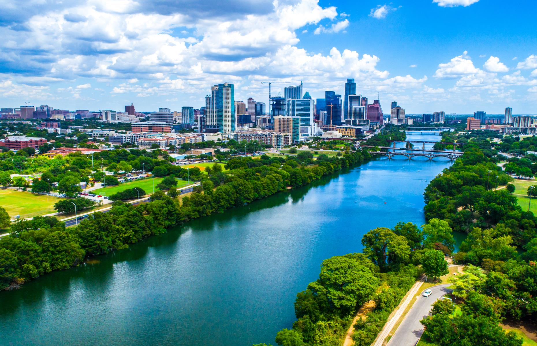 Slide 10 of 31: Although more famous for its musical connections, Austin has a surprising amount of green spaces – and blue, for that matter. Lady Bird Lake is actually a reservoir whose skinny shape makes it look more like a river.