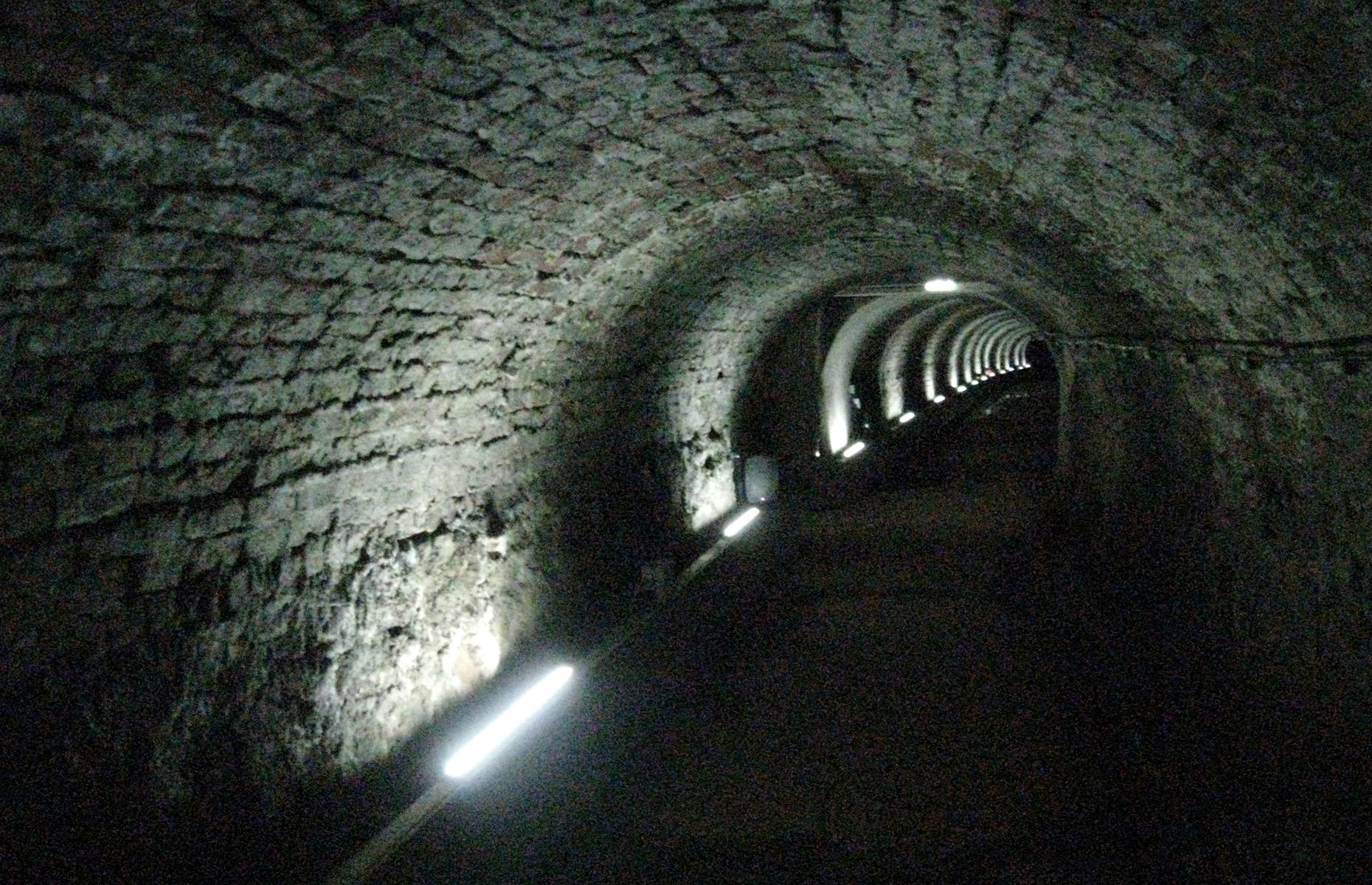 Slide 6 of 32: An eerie, preserved 19th-century wagonway runs under the northeastern English city of Newcastle to the Tyne River. Originally constructed to transport coal from a colliery to the river, it became an air-raid shelter during the Second World War. After undergoing repairs, the Victoria Tunnel finally opened for guided tours in 2010, and hour-long, single-household excursions are still available at present.