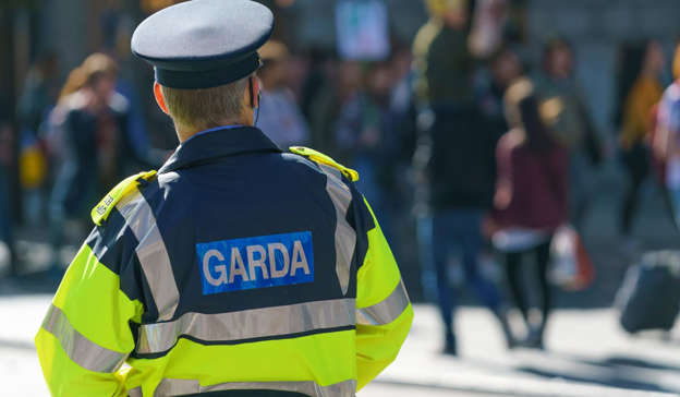 a man walking down the street: Gardai asked the victims of hate crime to report the incident to them and not to post on social media. Pic: Shutterstock