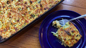 a plate of food with a slice of pizza: Zucchini Casserole