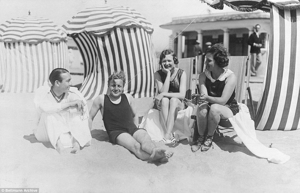 Slide 2 of 25: The well-heeled crowd included princesses countesses, ladies and majors, all enjoying a spot of sun, sea and frolicking in the sand. Pictured from left to right, actor Jack Pickford, literary magazine publisher Erskine Gwynne, Mrs. Pickford (Marilyn Miller) and a Mrs. Frieda Rossen, on the sands at this most fashionable summer resort.