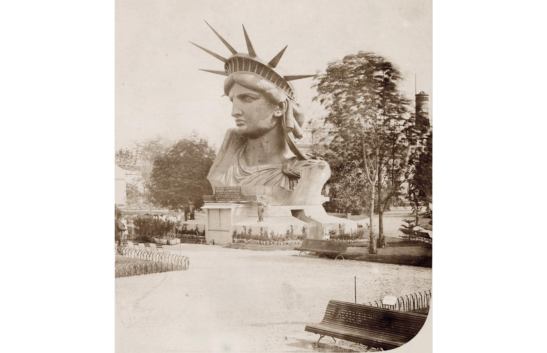 Slide 6 of 51: This famous statue didn't start its life in New York – in fact, it was displayed at the Paris World's Fair in 1878 (pictured), before being given to the US by France in 1886, to commemorate the alliance between the two countries during the American Revolution. A few decades later, the majestic statue, which stands on Liberty Island, had become one of the city's–and world's – best-loved landmarks.