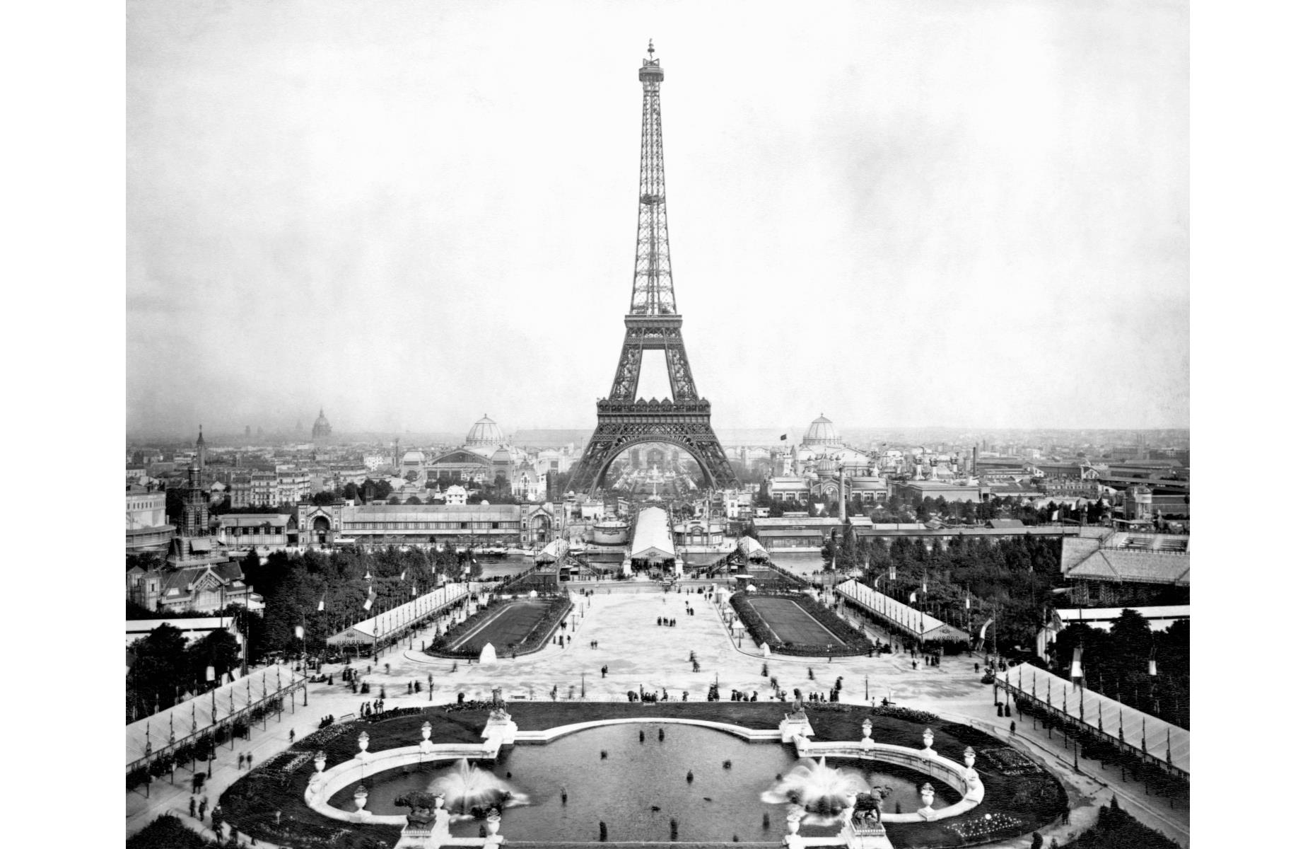 Slide 7 of 51: The most recognizable feature of the Paris skyline was built between 1887 and 1889, completed in time for the Paris World's Fair of 1889 – although it was only supposed to be a temporary structure. Its original licensing rights were only set to last 20 years and it was almost torn down in 1909, but city officials voted to keep it after recognizing its value as a radio station. Pictured here in 1889,the Eiffel Tower now typicallyattracts around sevenmillion visitors each year.