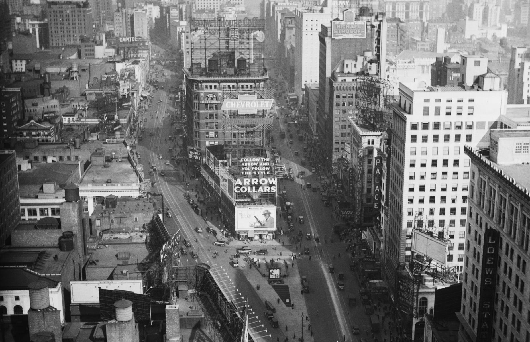 Slide 25 of 51: The Times Square of the 1920s (pictured here) is a far cry from the flashing lights and billboards of the Times Square we know today. Originally known as Longacre Square, in the 1880s it comprised a large open space surrounded by apartments, but shortly after that electricity arrived inthe area,and streetlights and theatersigns sprung up. It was renamed to Times Square in April 1904, after the New York Times, which was set to relocate its headquarters there in January 1905.