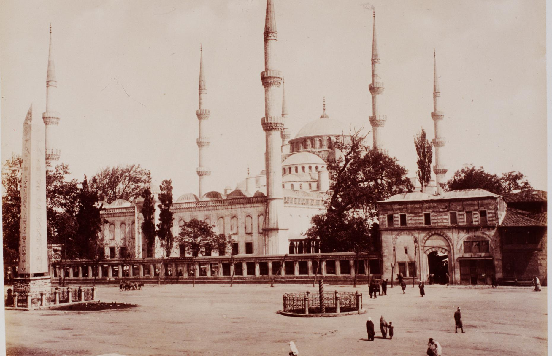 Slide 14 of 51: The Blue Mosque in Istanbul was built between 1609 and 1616, as a way for Sultan Ahmed I to reassert the Ottoman Empire's power following the Peace of Zsitvatorok (1606) and losses in wars with Persia. With six minarets, five main domes and eight smaller domes, it's one of the most impressive surviving mosques from the Classical period. Today it usually attracts around five million people each year, although it hasn't always been so popular – in this photograph from 1899, the outside of the mosque looks eerily quiet.
