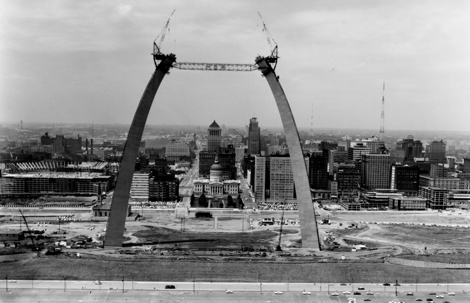 Slide 44 of 51: St. Louis' famous Gateway Arch was built between 1963 and 1965 and was created to symbolize the movement of settlers towards the American west, a concept pioneered by Thomas Jefferson. Pictured here towards the end of its construction in 1965, the arch's final keystone is thought to contain a time capsule filled with letters written by more than 760,000 local people.