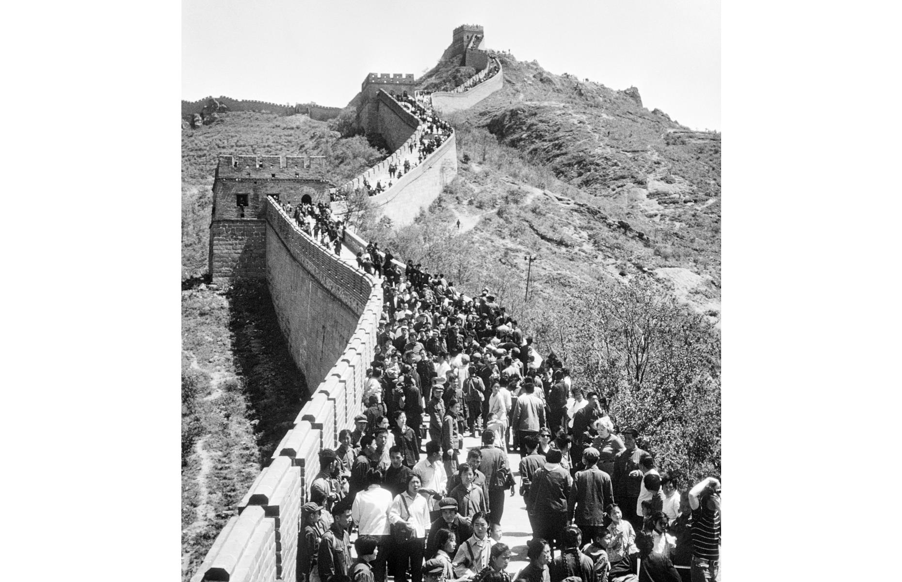 Slide 46 of 51: It turns out overcrowding at the Great Wall of China is nothing new – if this photograph from the 1970s is anything to go by. The landmark, which has an official length of 13,170 miles (21,196km), was mainly built during the Ming dynasty, which lasted between 1368 and 1644. In 2018, the most popular section of the Great Wall, Badaling, received more than 9.9 million visitors, reaching 80,000 a day during peak season.