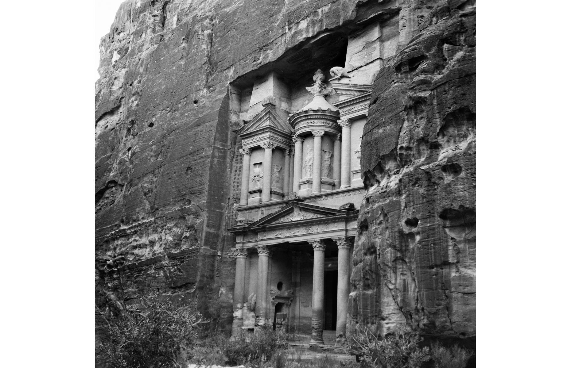 Slide 15 of 51: Carved into red, pink and blue sandstone among winding desert canyons, The Treasury (Al Khazneh) is part of the 'Lost City' of Petra. This prehistoric settlement, pictured in 1900, was once the capital of the Nabataean Empire, which controlled a vast swathe of the Middle East before being absorbed by the Roman Empire.It was declared a UNESCO World Heritage Site in 1985 and since then tourism has been on the rise. Now take a look at the amazing lost cities we've only just discovered.