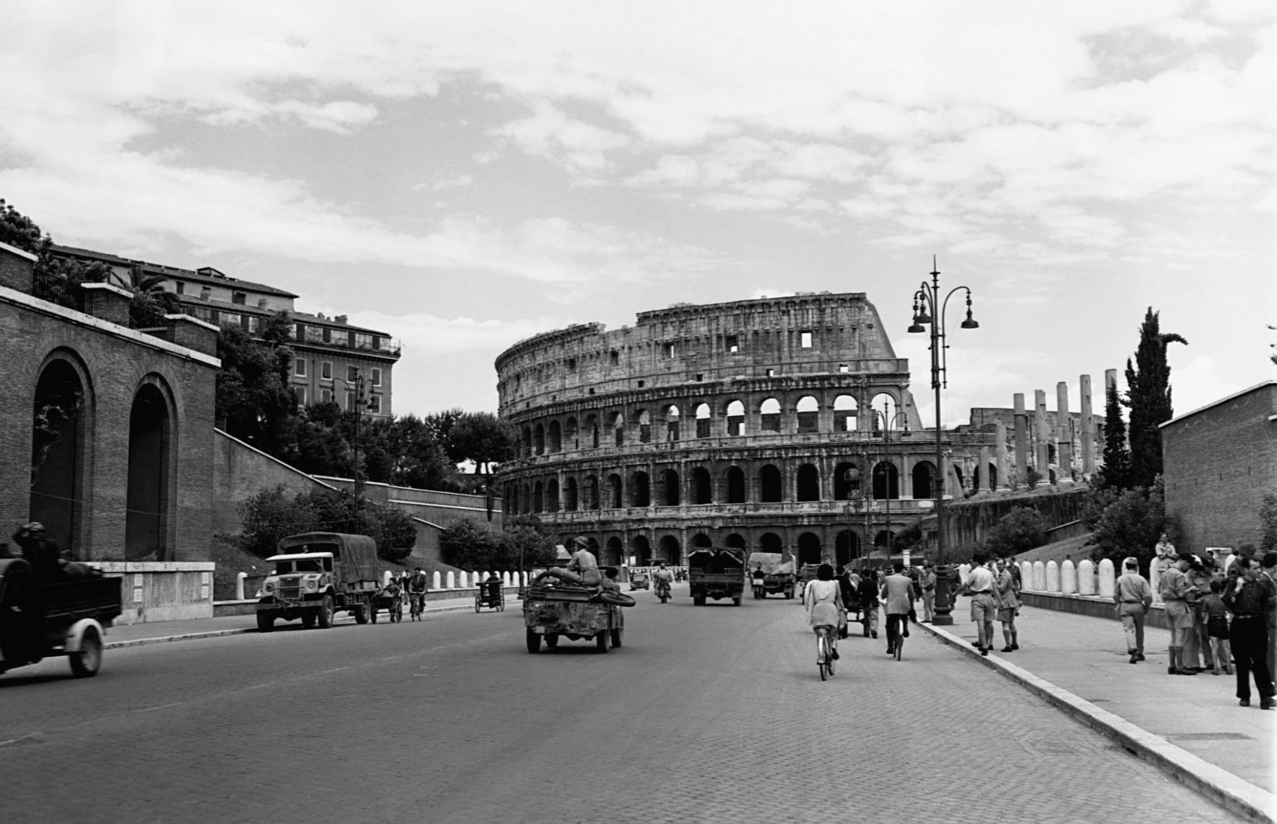 Slide 50 of 51: The Colosseum is a large stone amphitheater in Rome which was built in AD70-72. Commissioned by the Flavian Emperor Vespasian, who ruled the Roman Empire between AD69 and 79, it was created to host gladiatorial combats and other forms of public entertainment. The city of Rome became popular with tourists in the mid-1800s, although political upheaval led to a decline in tourism in the 1870s that lasted until the end of the Second World War. Looking quiet in this shot from 1944, it wasn't until the 1950s that tourism picked up again, thanks in part to popular movies including Roman Holiday and La Dolce Vita which were filmed in the city. Now discover the famouslandmarks that were almost destroyed