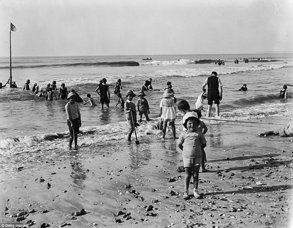 Slide 6 of 25: The beaches were very popular with families as shown in this picture taken in September 1919.