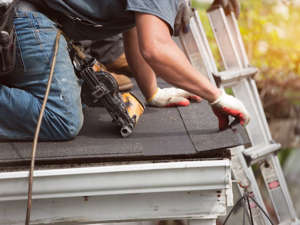 a man sitting on a bench: We get it — it's easy to forget about something you hardly ever lay eyes on, but neglecting your roof can lead to unwelcome outcomes like moisture damage, structural problems, mold growth, and more. Experts recommend you check your roof — or have it checked — at least a couple times of year for missing or damaged shingles or tiles; plant, moss, or mildew growth; and any other signs of deterioration.   Related: DIY Disasters: 20 Repairs to Leave to the Pros
