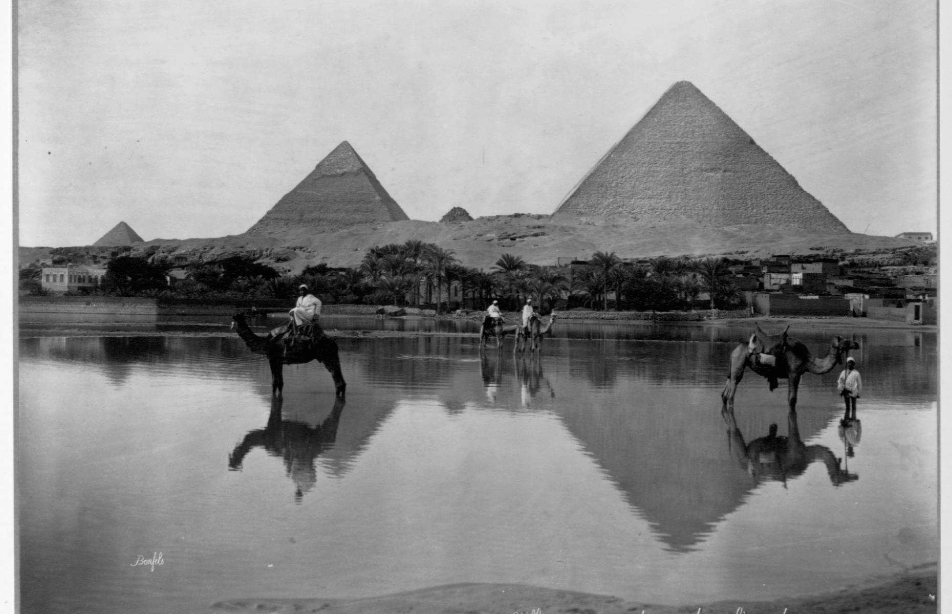 Slide 8 of 51: The Giza Pyramids are among the last surviving Ancient Wonders of the World, dating back to the 4th dynasty (circa2575–2465 BC). The three pyramids, the largest of which originally measured 481.4 feet (147m) tall, represent three kings:Khufu, Khafreand Menkaure. Since the Egyptian government's push to increase tourism in 1975, visitor numbers have increased, peaking at a record 15 million in 2010 before dropping off due to political turmoil and violence. The Pyramids are pictured here in 1890. Discover the incrediblesecrets of the world's ancient wonders.