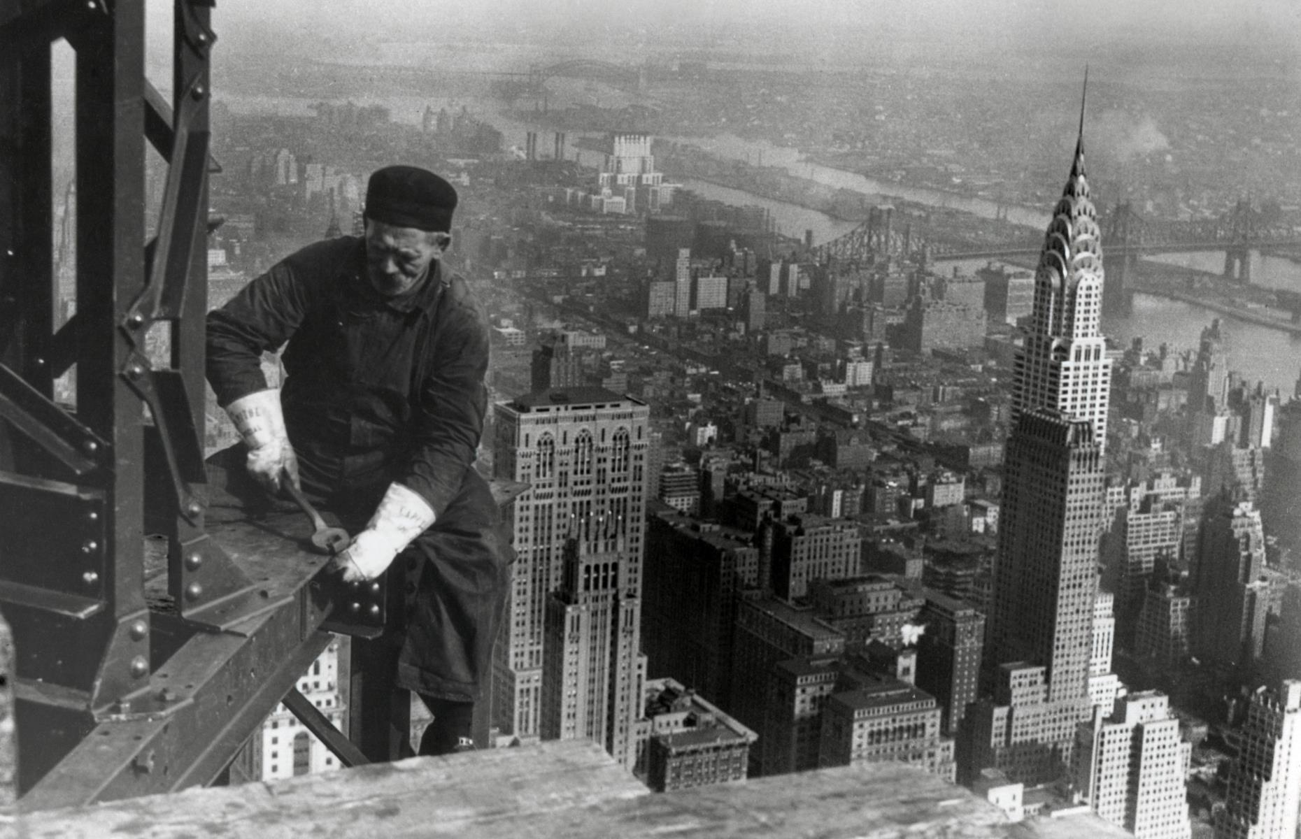 Slide 29 of 51: Pictured here under construction in 1931, New York's Empire State Building took just one year and 45 days to build. It was the tallest building in the world until the 1970s, when it was replaced by the World Trade Center. Today, more than four million visitors usually take the trip up to the Empire State Building's 86th and 102nd floor observatories each year, to gaze at the city's views from up high.