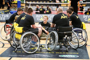 Prince Harry et al. riding on the back of a bicycle: Chris Jackson/Getty Prince Harry at an Invictus Games event