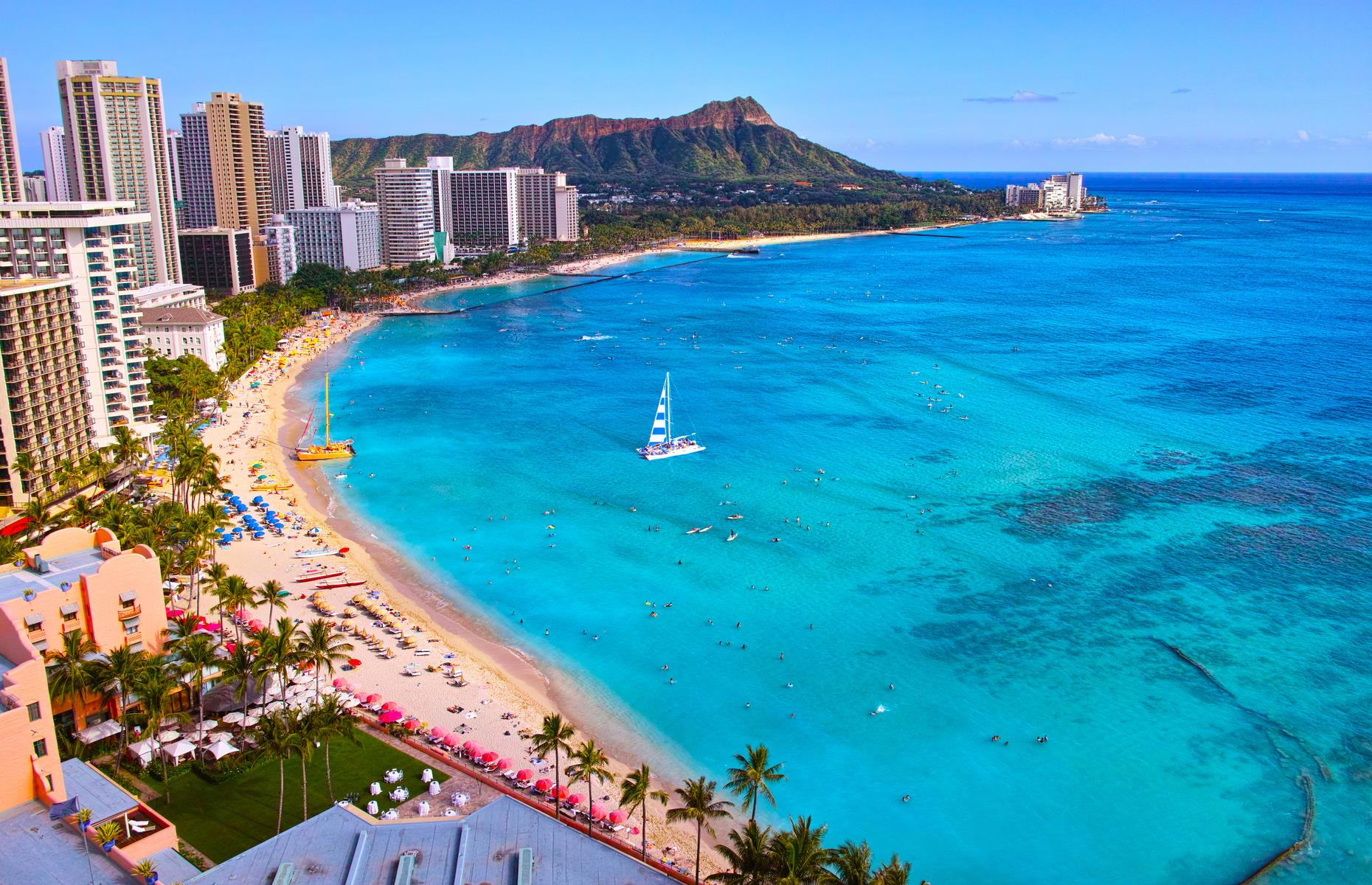 Slide 36 of 49: Waikiki in Oahu is Hawaii's most famous beach resort, a busy, sandy playground with legendary surf. Yet the island has plenty of sandy strands, and those who venture to shores further afield will be rewarded with extra space, peace and quiet.
