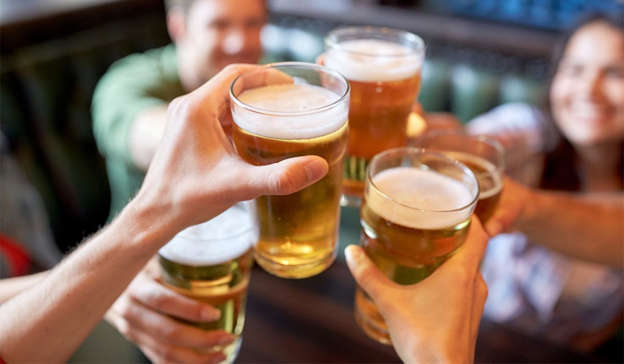 a close up of a glass of beer on a table: The comments were made against a backdrop of increasing unease over the reluctance of the Coalition to provide a timeline for the reopening of pubs. Pic: Shutterstock