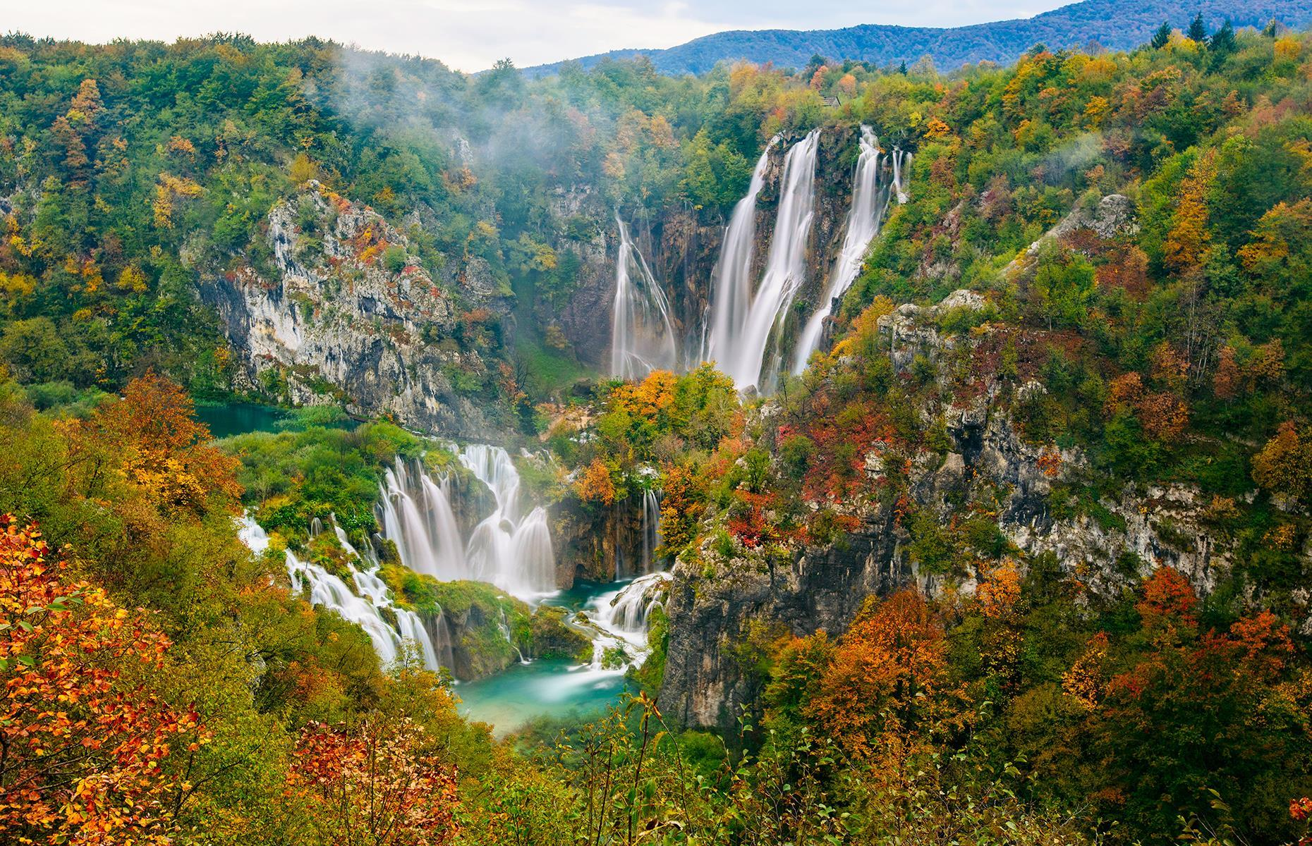 Slide 9 of 41: Covering almost 115 square miles (298sq km), Plitvice Lakes National Park is found near the Bosnia and Herzegovina border, two hours south by car from Zagreb in Croatia. The park, founded in 1949, is famous for its collection of 16 crystal clear, color-changing lakes – they morph between shades of green and blue due to their high mineral content – plus over 90 waterfalls. It's a truly magical landscape. Here are stunning images of Europe's best national parks.