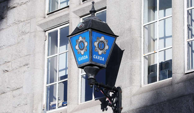 a clock on the side of a building: Gardai arrested seven men involved in a potential blackmail and extortion plan in County Cavan on Sunday afternoon. Pic: Niall Carson/PA Wire