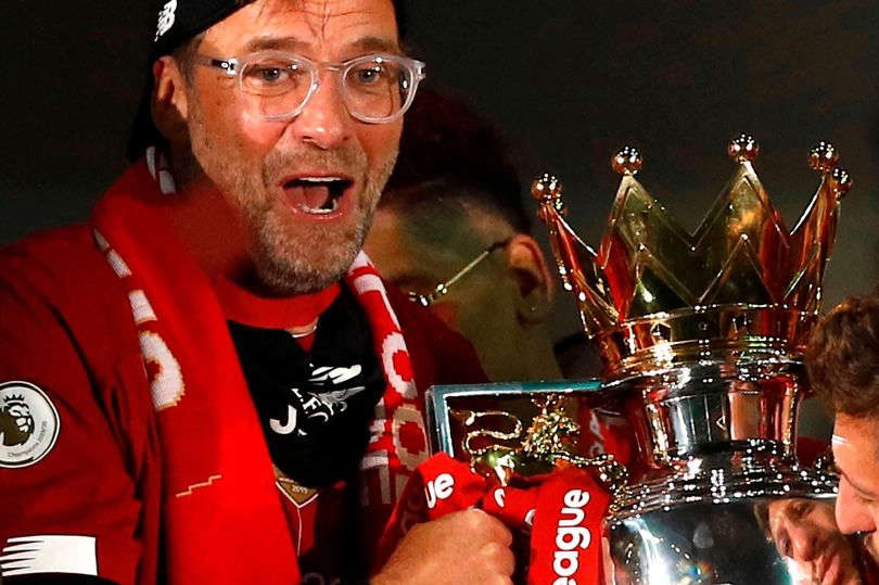 a man wearing glasses: Klopp has won the Premier League with Liverpool