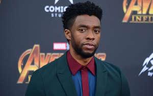 Chadwick Boseman wearing a suit and tie: In this file photo taken on April 23, 2018 Actor Chadwick Boseman arrives or the World Premiere of the film 'Avengers: Infinity War' in Hollywood.