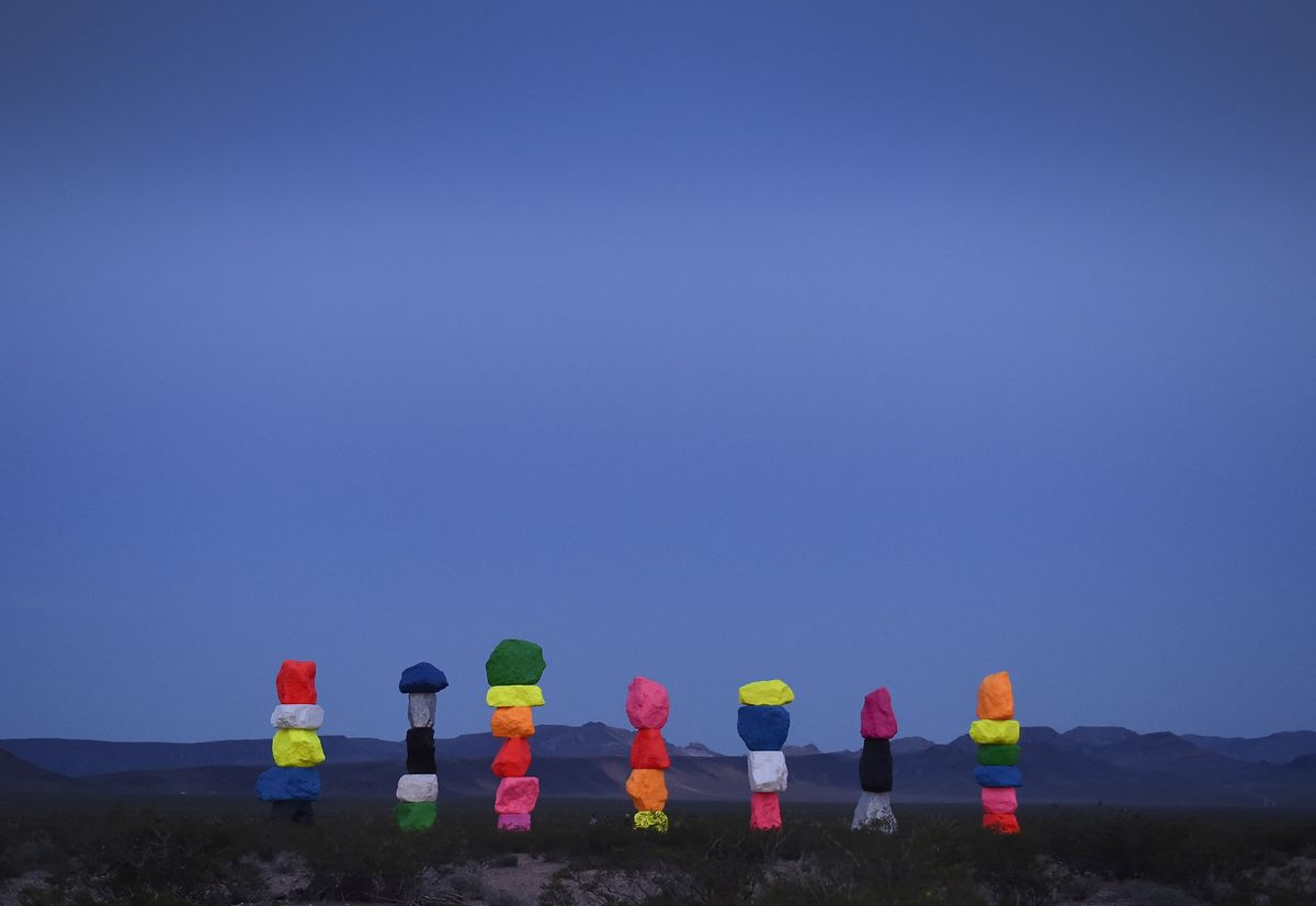 Slide 2 of 18: Standing in the midst of the Las Vegas desert, is this brightly colored art installation. It is seven towers of vivid boulders stacked 30 feet high, which bring color to the dry landscape around it. It's currently slated to be there until 2021.