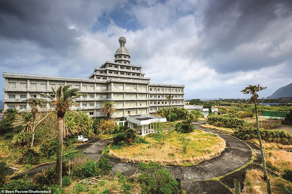 Slide 6 of 22: Derelict hotel, Hachijojima, Izu Islands, Japan: In the early 1960s, Japan was economically on the rise, but a cautious government discouraged foreign travel. Instead, the newly affluent were encouraged to find their jet-set luxury nearer home. Hachijojima was being billed as the 'Hawaii of Japan' and The Royal Hotel, pictured, was its five-star centerpiece. French Baroque met modern brutalism in its design. In fairness, its guests were happy here and the hotel was a huge success – until restrictions were relaxed and alternative destinations brought within their reach. In the 1990s the hotel closed and has since stood empty, gradually decaying.