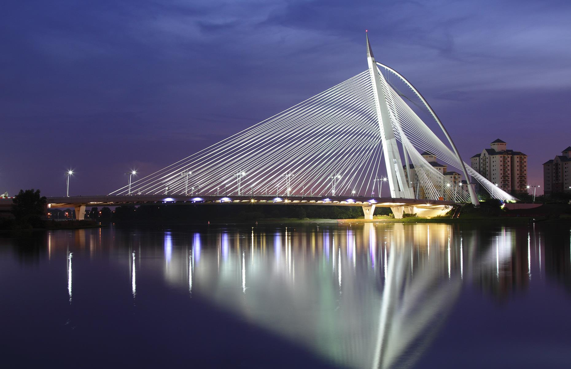Slide 26 of 31: Malaysia's futuristic Seri Wawasan Bridge, built to resemble a sailing ship, certainly makes a statement. The cable-stayed structure, finished in 2003, rises above man-made Putrajaya Lake and looks especially spectacular when lit up at night.