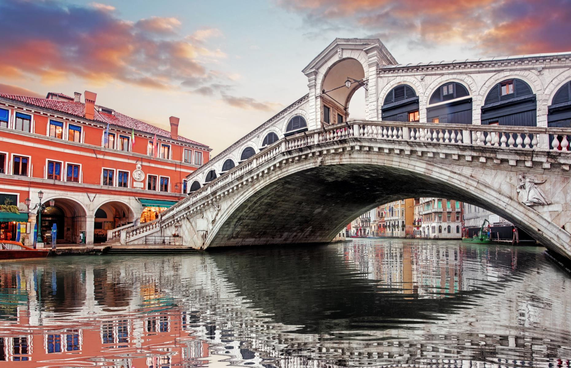 Slide 3 of 31: The 16th-century Rialto Bridge – or Ponte di Rialto – crosses over the narrowest point of Venice's Grand Canal, and is held up as a great feat of Renaissance-era architecture. An elegant arch complete with stone reliefs, Rialto replaced a wooden structure that had existed here since the 12th century and today it's the oldest bridge to span the famous canal.