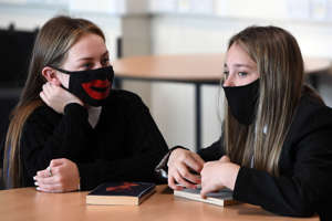 Pupils wear face masks as they sit in class at Springburn Academy school in Glasgow on August 31, 2020 as mandated by new guidance from the Scottish Government to reduce the risk of the spread of the novel coronavirus. - Pupils in Scottish secondary schools must now wear face masks in communal areas as a measure to reduce the risk of transmission of the novel coronavirus. (Photo by Andy Buchanan / Digital / AFP) (Photo by ANDY BUCHANAN/Digital/AFP via Getty Images)