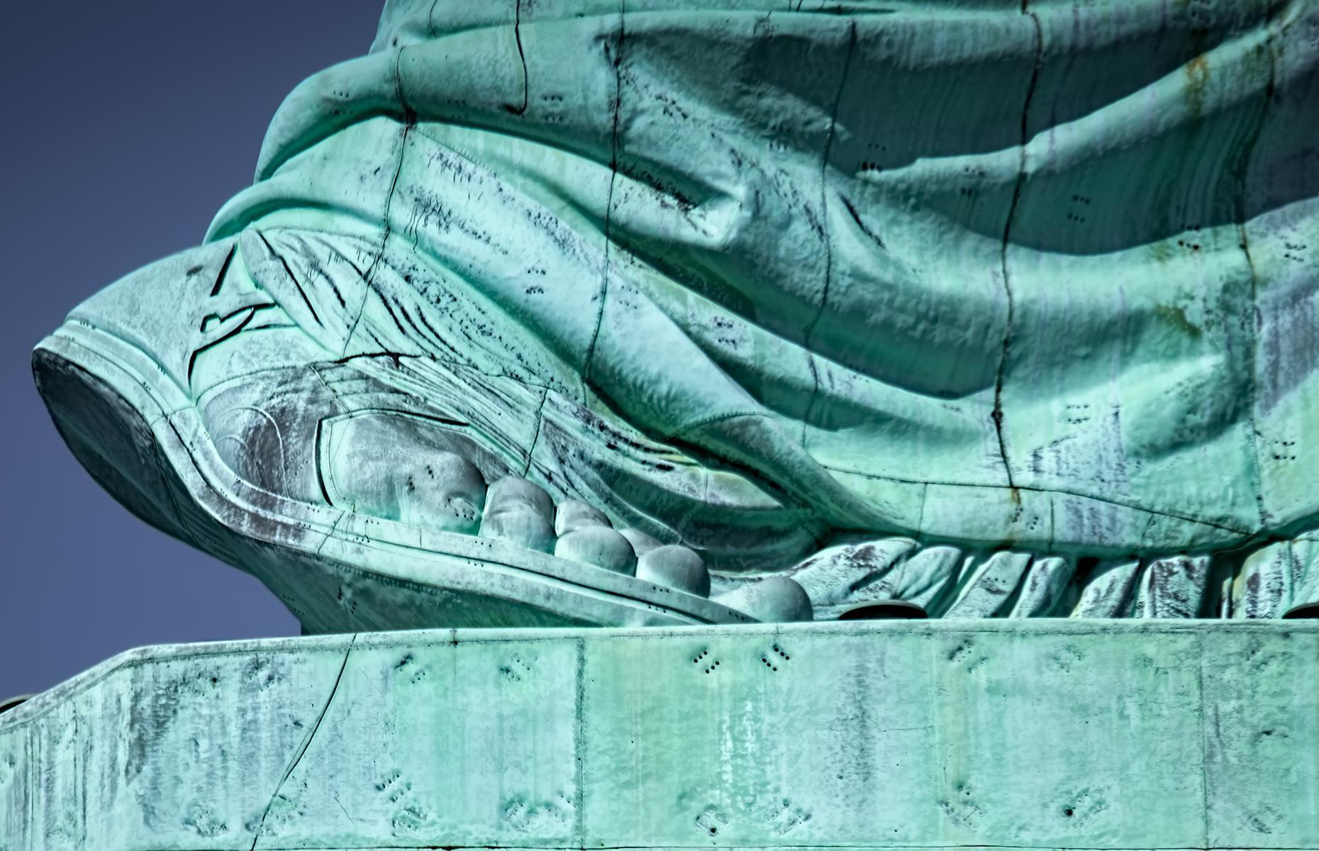 Slide 44 of 53: These are the toes of Libertas, the Roman goddess of liberty, who used to welcome immigrants arriving on ships to one of the biggest cities in the world.
