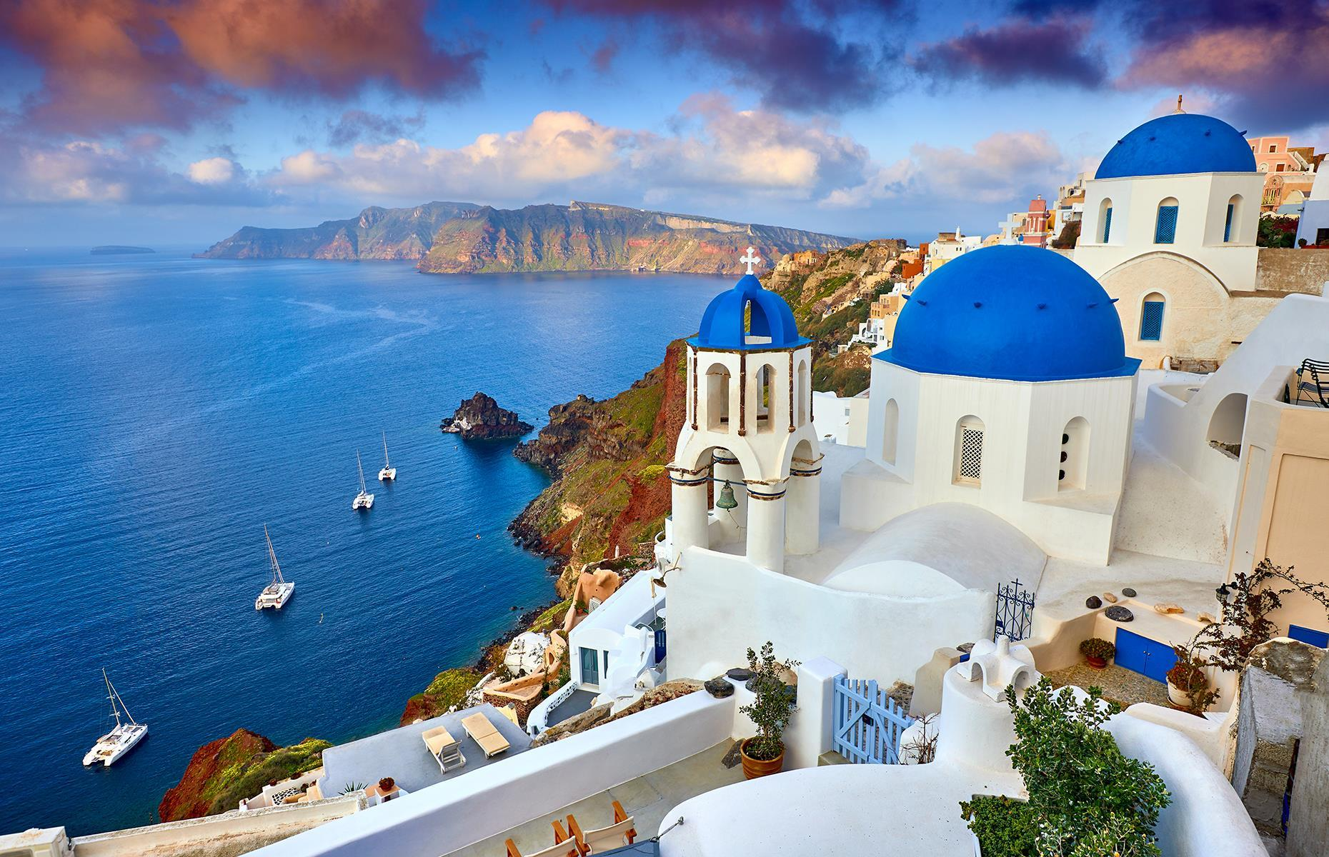 Slide 17 of 53: Known as the Queen of the Aegean, Santorini is often dubbed one of the most beautiful islands in Greece. Balmy temperatures, sugar-cube architecture and plush accommodation have enticed visitors for decades.