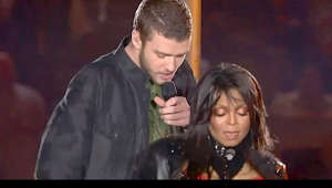 "Janet Jackson holding a glass of wine: Janet Jackson and Justin Timberlake performing ""Rock Your Body"" together at the 2004 Super Bowl, during which the infamous wardrobe malfunction occurred."