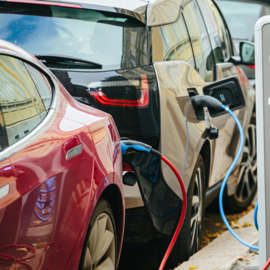 a close up of a car: electric vehicles charging at a charging station. electric vehicle stocks