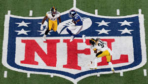 New York Giants wide receiver Sterling Shepard (87) catches a pass in front of Pittsburgh Steelers strong safety Terrell Edmunds (34) and linebacker Devin Bush (55) during the first half at MetLife Stadium.