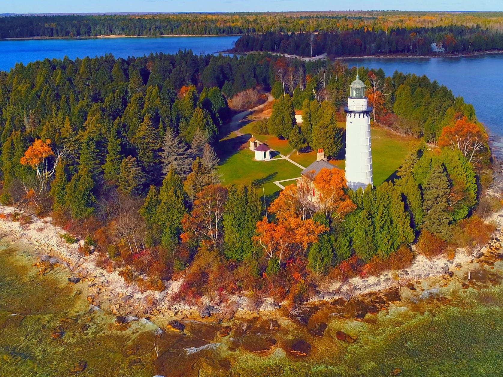 Slide 11 of 17: Door County is said to be one of the best fall foliage spots in the Midwest.You can drive down highways 57 or 42 to see all of it, with lighthouses and European-styled buildings along the way.There are also really cute towns and orchards to visit throughout the peninsula, where you can stop in for events, local art, and great food.It's best to visit in early October when all the leaves have changed but before it's too cold.