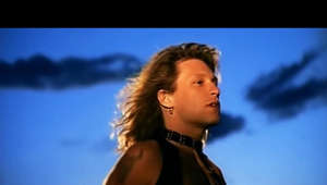 a person looking at the camera: Music video by Jon Bon Jovi performing Blaze Of Glory. (C) 1990 The Island Def Jam Music Group  #JonBonJovi #BlazeOfGlory #Vevo