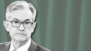 Jerome Powell wearing glasses posing for the camera: Powell warns failure to reach COVID-19 deal could 'scar and damage' economy