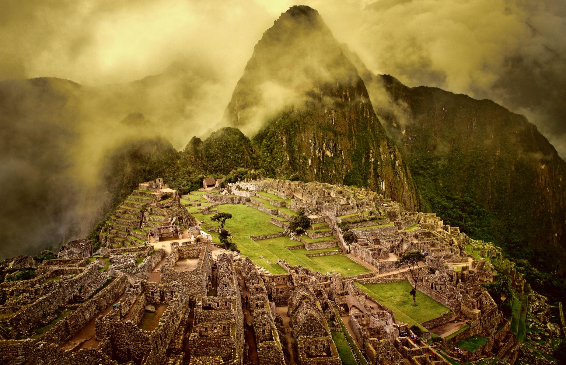 Slide 2 of 30: Built on an 8,200-foot (2,500m) ridge, the world's most famous Inca site has a spectacular setting amid the Andean peaks of southern Peru. The stonemasons who constructed this city in the 15th century didn't use mortar with the 150 buildings made from fine dry stone walls. Mystery still surrounds the purpose of the citadel, but it's thought to have been both a residential and religious center. The name Machu Picchu is interpreted as Old Mountain.