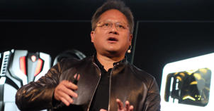 Jen-Hsun Huang wearing a suit and tie: Jensen Huang, president and CEO of Nvidia, speaks during the Computex Show in Taipei on May 30, 2017.